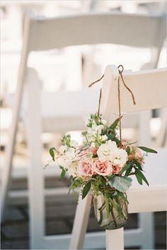 Too many flowers, but a great idea.  wedding aisle decor ideas