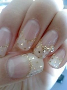 White tip French manicure with gold glitter smile line, gold polka dots, Gold Alloy bow with clear crystals free hand nail art