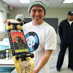 Jim Murphy and artist Holly Nordlum worked with local youth to personalize skateboard decks with art inspired by the Anchorage Museum and Smithsonian collections during the Skate Art workshop. Photo by Brian Adams