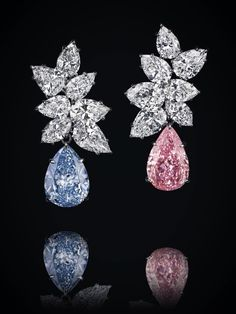 A PAIR OF COLOURED DIAMOND AND DIAMOND EAR PENDANTS, BY BULGARI. The diamond cluster top, weighing a total of 19.28 carats, suspending a detachable pear-shaped blue diamond, weighing 6.95 carats, and a pear-shaped pink diamond, weighing 6.79 carats, mounted in platinum and gold, 4.0 cm. Price Realized $16,056,734 // Estimate $11,966,623 - $15,088,351. GIA / Fancy Vivid Blue, SI2. Type IIb // Fancy Vivid Pink, VS2. Type IIa [C. MAGNIFICENT JEWELS - 11 Nov. 2014 - Geneva] #Vivid #Blue #Pink