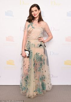 Unique: The 34-year-old Devil Wears Prada star delighted in a sheer nude frock which featured plenty of leafy and floral patterns, in addition to images of several animals