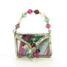 Stained glass brooch in the shape of a purse, with a Swarovski crystal handle