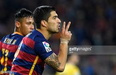 Barcelona's Uruguayan forward Luis Suarez celebrates after scoring during the Spanish league football match FC Barcelona vs Real Sporting de Gij��n...