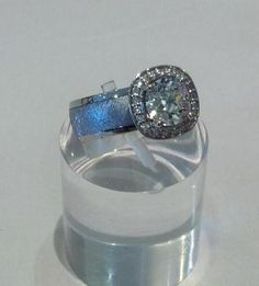 Fabulous unique engagement ring with an heirloom diamond (over 100 years old) set in a fresh halo of diamonds and white gold on a meteorite ring. Breathtaking!