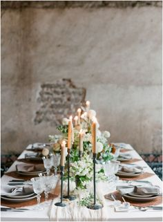 Centerpiece, candles and white linens
