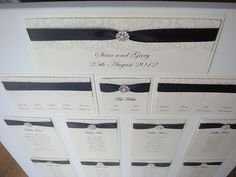 Vintage wedding table plan with lace and a pearl embellishment. Shown in Black