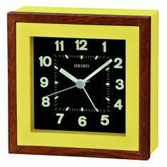 Yellow wooden bedside alarm clock. Would add a great pop of color to any room though. By Seiko.