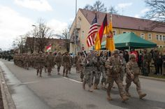 The leaders of the 3rd Squadron, 2nd Cavalry Regiment pass by the review booth as they parade through Rose Barracks in Vilseck, Germany, on April 1, 2015, at the conclusion of a 13-day long convoy that marked the end of their participation in the Operation Atlantic Resolve. (MICHAEL S. DARNELL/STARS AND STRIPES)