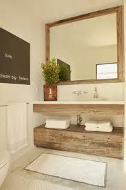 love this: bathroom and storage! Lovely powder room features reclaimed wood mirror over floating reclaimed wood vanity paired with white top and wall-mounted faucet stacke dover reclaimed wood cabinet atop white penny tiled floor. Reclaimed Wood Mirror, House Bathroom, Interior, Cottage Bathroom, Rustic Bathrooms, Bathrooms Remodel, Reclaimed Wood Cabinet, Beautiful Bathrooms, Bathroom Inspiration