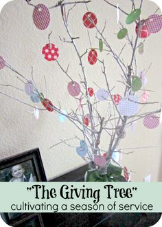 DIY Giving Tree {Holiday Craft} -  When we do a small act of kindness or a service for someone, we write it down and hang it on our tree. This is a fun way for us to record and promote the good we do for each other, in our family and in our community.