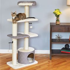 Your kitty clan will be living the high life when this 5-tier cat tower with sisal scratching posts moves into your home. Large Cat Tree, Diy Cat Tree, Wood Cat, Cat Towers, Cat Scratching Post, Cat Condo, Cat Furniture, Cat Supplies, Pet Beds