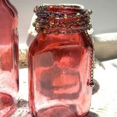 "Mix mod podge or elmers glue with food coloring, ""paint"" the outside of a vase, and let it dry :)  Just don't get it wet"