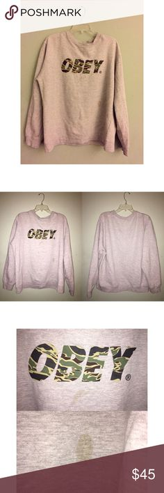 Camo Font Obey Sweatshirt I got this sweatshirt a while ago and well, it is too big for me, but I sure did wear it lol! It has 2 stains, which I showed in photos above, but honestly, they are not noticeable! The sweatshirt is really cozy and fashionable! It is legit, real Obey! Obey Tops Sweatshirts & Hoodies