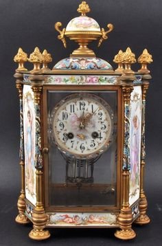 A Fine 19th Century French Champleve Enamel And Porcelain Mantle Clock.