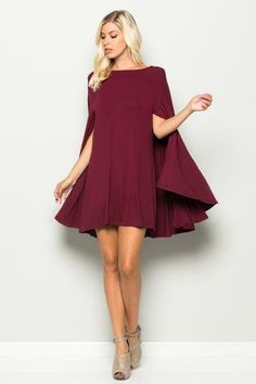 The hottest style for 2016! This cape swing dress easily works for day or night. It would be great for that office holiday party or any red carpet. View Size Chart
