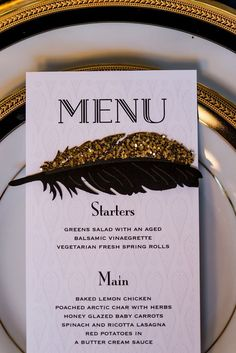 Gold and black art deco inspired menu card and place setting #wedding #menu #gold #gatsby #feather