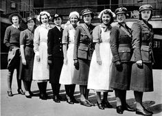 A row of Harrods employees, each wearing the uniform of a different women's service (nine in total).