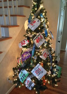 Race bibs Christmas tree. Made with race bibs and race medals. 6.5 ft tree.