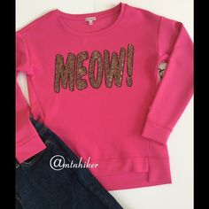 """Host Pick Juicy Couture Top """"Meow"""" NWT This fun sweatshirt style pink top has slight high/low styling and says """"MEOW"""" in sequins. The soft fabric is 95% polyester; 5% spandex with a smooth finish (not fleece)  Measurements: chest 37""""; length 22"""" in front; sleeve 20"""". Has some stretch  Condition: NWT, no damage or defects  Smoke free home   Style Obsessions Host Pick by @conniemarie12  Juicy Couture Tops"""