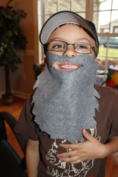 """Duck Dynasty party -the birthday boy in his Uncle Si beard! Grey felt (could have done brown for the other guys too, but it was more of a """"Si only"""" party, lol). Hole puncher. Elastic. Measure length and elastic size to a child's face/head. Tied double knots to keep the elastic in place. The boys LOVED these and this was one of the party favors too."""