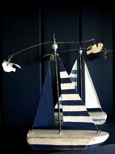 decorative boat - nautical theme nursery idea