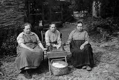 Three of the Walker sisters are shown ginning cotton in a photograph from the Great Smoky Mountains National Park's new 75th-anniversary Web site. The sisters were granted a lifetime lease in the park and dwelled at their cabin, without electricity or plumbing, for the rest of their lives. The last of the sisters died in the 1960s