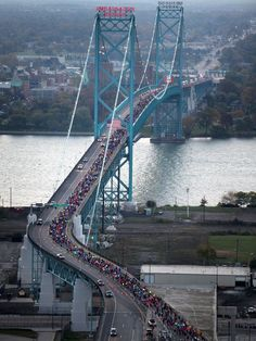 The Aerial view of runners crossing the Ambassador Bridge into Canada during the 2013 Detroit Free Press/Talmer Bank Marathon in Detroit. Can you see me? Detroit Rock City, Detroit Area, Detroit Michigan, Detroit Ruins, Detroit Motors, Windsor Ontario, Windsor Canada, Detroit History, Detroit Free Press