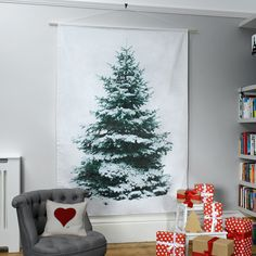 Not on the High Street – Best hung against a white wall to enhance the trompe-l'oeil effect, this Christmas treet wall hanging by Betsy Benn features a lush green fir tree: tape decorations to the fabric to complete the look. A simple, effective display that won't shed needles or lose colour over time. £75 (notonthehighstreet.com)