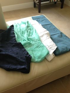 wedding colors - navy, bright mint/seafoam green, lighter blue, beige & white  groomsmen in navy shirt and beige/light khaki pants bridesmaids in seafoam green dress groom in light blue pants and white linen shirt