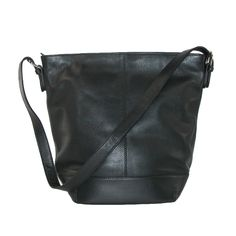 Leather Bucket Shoulder Handbag by ILI. This handbag has high quality material and construction.  The large body makes room for anything you need while out.  The multiple pockets store smaller items and the convenient outer cell pocket makes it more convenient to grab your phone.