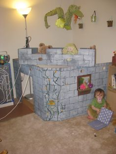 Play castle made from a box. I have a dragon like this around somewhere...