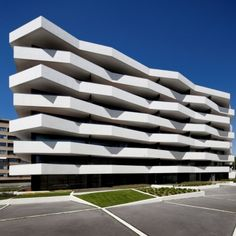 Living Foz: Architects: dEMM Arquitectura Location: Porto, Portugal Constructed Area: 12.000 sqm courtyard Project Year: 2008-2010 Angled balcony promotes the dynamics of the building enriched by contracts of light and shade.