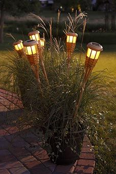 Use Dollar tree solar lights in tiki torch bases..... CB | Our ...
