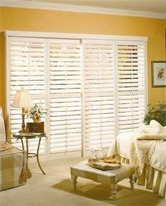 Plantation Shutters on a track to allow access to a sliding glass door
