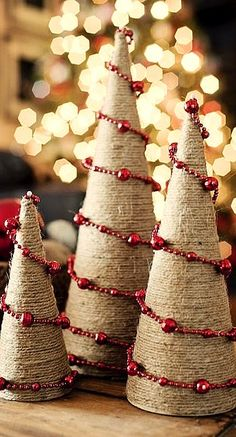 Rustic twine wrapped trees with bead garland.