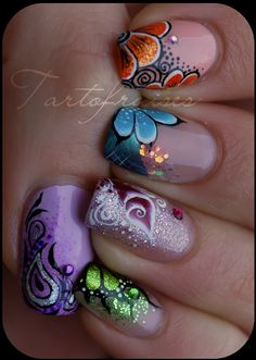 flowers nail art.u could choose one colour and use for bridesmaids nails.....paint 8 nails plain colour and 2 nails with flower.