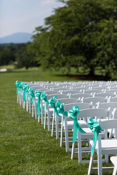 Aqua ribbon aisle markers {Photo by Cramer Photo via Project Wedding}