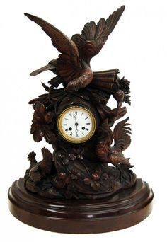 This magnificent timepiece features a large carved figural eagle, cock and hen. A nice example of the wonderful carved clocks from the Black Forest region. Victorian Clocks, Antique Clocks, Black Forest Wood, French Clock, Mantel Clocks, Eagle, Clock Art, Carving, Antiques