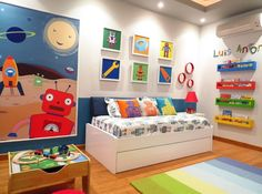 Bedroom:Appealing Colorful Robotic Child Bedroom Design With Small White Trundle Bed And Strip Gradation Colour Rug Mix Book Four Level Shelving And Picture Frames Also Wooden Flooring Inspiring  Bedroom Design That Bloom With Your Kids