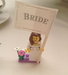 Lego figures used instead of place cards - a unique idea but also creates a nice memorable wedding favor for the guests