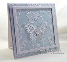 handmade card ... Lifestyle Butterfly embossing folder ... looks like fine china (Belleek) in baby blue and white ... faux letterpress using the inked embossing folder technique ... Memory Box butterfly ... luv the floating frame cut with nesting squares .... beautiful card!