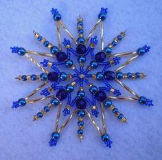 Korálková+hvězda+modrozlatá+Hvězda je+vyrobena+z korálků+modré+a+zlaté barvy.+Je+na+pevné+drátěné+konstrukci. +Velikost+hvězdy+cca+10+cm.+Hvězdička+se+hodí+pro+sváteční+výzdobu+Vašeho+bytu+nebo+může+posloužit+i+jako+malý+originální+dáreček.