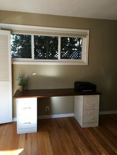 DIY Desk Made From Spray Painted Filing Cabinets With A Stained Wood Top