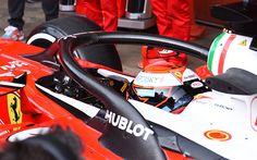 Ferrari's Kimi Raikkonen tests F1's new halo head protection system during testing in Spain