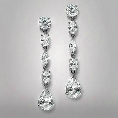 """LucyAlia's radiant 1 3/4"""" h linear wedding or prom dangle earrings have a mix of round, marquis, oval & pear shape Cubic Zirconia to light up any special affair! Our top-selling silver rhodium dangle earrings are popular for bridesmaids or homecoming as well!"""