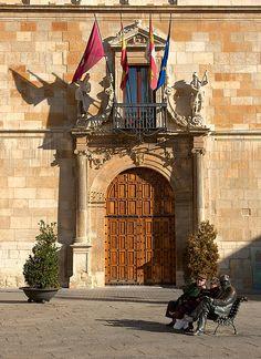 Iron man in front of Casa de los Guzmanes, Leon, Spain