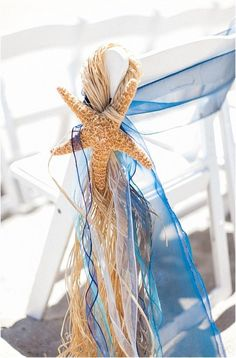 Every beach wedding needs starfish details. We love these ceremony decorations!