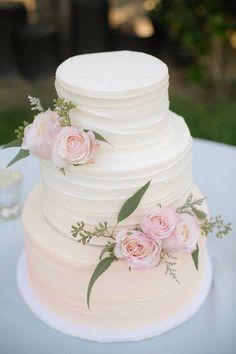 All-white wedding cake with gorgeous blush pink flowers #weddingcake #whitewedding