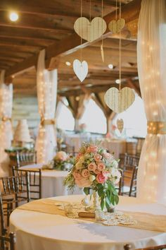 Barn recpetion via Southern Weddings Visit my Blog for more inspiration---I like the hearts and the lights and fabric covering the posts