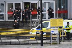 MANCHESTER, ENGLAND - OCTOBER 11: Armed police surround Arndale shopping centre, where a man allegedly stabbed five people on October 11, 2019 in Manchester, England. A man in his 40s was arrested on suspicion of assault, as paramedics treated five people for stab wounds at Manchester Arndale, a large shopping complex in the city centre. (Photo by Anthony Devlin/Getty Images) via @AOL_Lifestyle